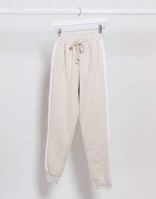 The Couture Club loungewear jogger with contrast side stripe in beige