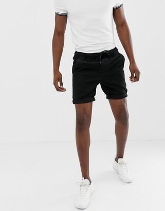 ASOS DESIGN skinny chino shorts with elastic waist in black
