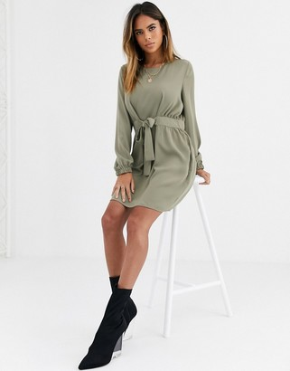 Asos DESIGN chuck on tie waist mini dress with long sleeves in khaki