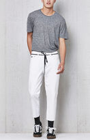 PacSun Wavyyy Slim Taper Cropped White Jeans