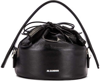Jil Sander Small Drawstring Drum Bag in Black | FWRD