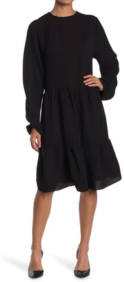 Velvet Torch Long Sleeve Ruffle Hem Dress