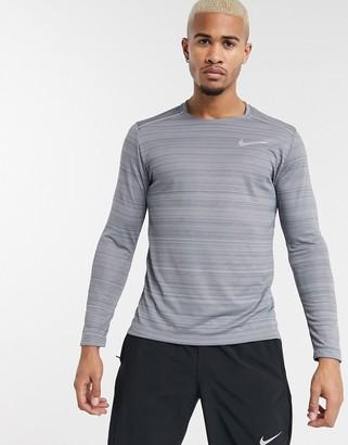 Nike Running Miler long sleeve top in grey