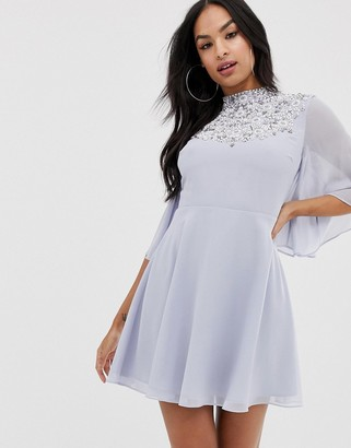 Asos DESIGN mini dress with flutter cape and pretty pearl embellishment