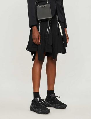 Black Comme Des Garcon Asymmetric-hem crinkled-textured twill shorts