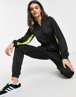 Dr. Denim Axis satin zip up jumpsuit in black with neon stripe