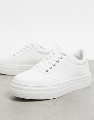 Accessorize flatform trainers in white