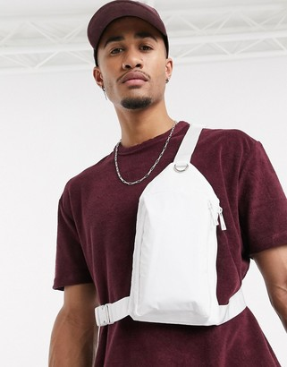 Asos DESIGN cross body harness bag in white faux leather with metal detail
