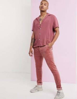 ASOS DESIGN skinny fit cord trousers in pink