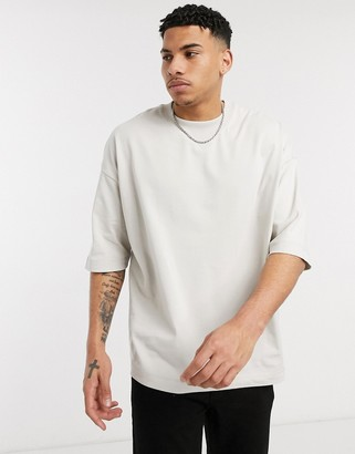 ASOS DESIGN oversized heayweight t-shirt with half sleeve and chunky neck in beige