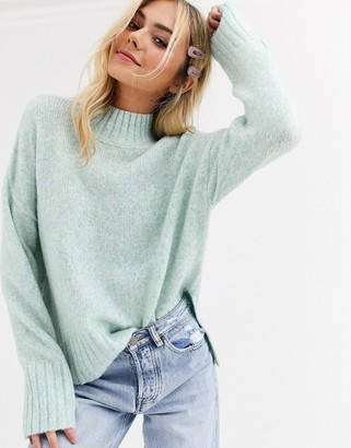 New Look high neck drop hem jumper in light green