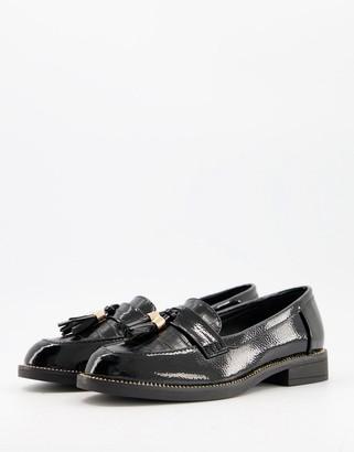Schuh Lailah tassel loafers in black croc