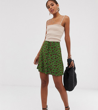 Asos DESIGN Tall button front mini skirt in green floral print