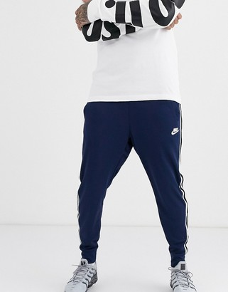 Nike Tribute cuffed joggers in navy
