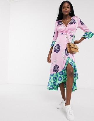 Liquorish contrast hem oversized floral wrap dress in pink and green