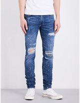 Amiri Distressed Skinny-fit Mid-rise Jeans