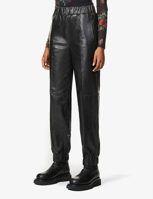 Ganni Tapered high-rise leather trousers