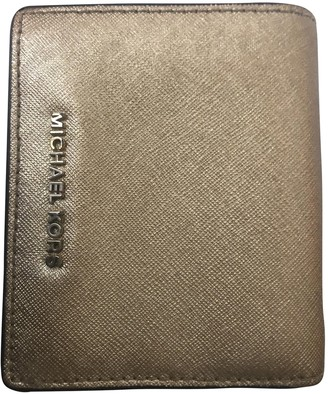 Michael Kors Gold Leather Wallets