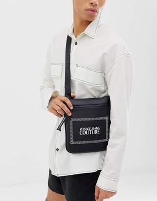 Versace cross body bag in black with logo