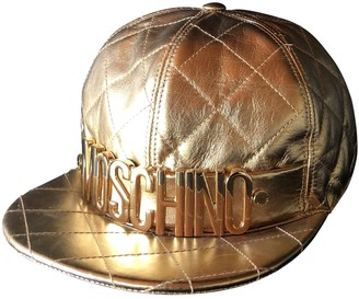 Moschino Gold Leather Hats