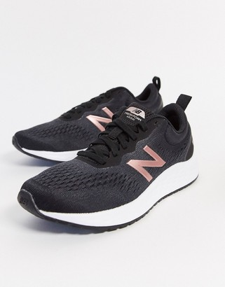 New Balance Running Arishi trainers in black and pink