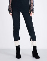Ann Demeulemeester Lace-trim straight cropped mid-rise satin trousers