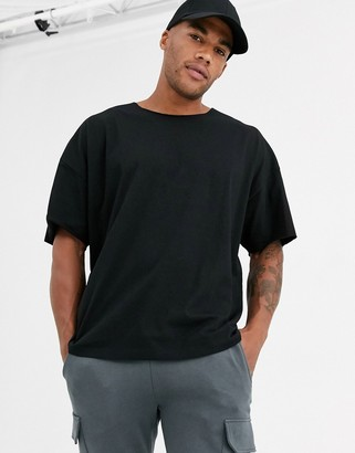 Asos DESIGN oversized t-shirt with raw neck in black