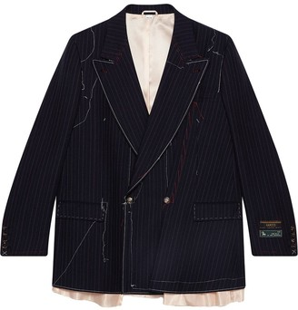 Gucci Asymmetric pinstripe jacket with stitching