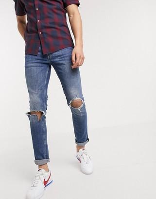 Topman organic skinny jeans in mid wash blue
