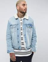 Asos Borg Lined Denim Jacket In Mid Wash