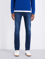 Calvin Klein Slim-fit tapered mid-rise jeans