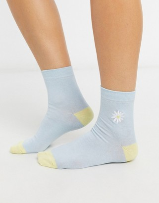 Asos DESIGN embroidered daisy ankle sock in blue with contrast heel and toe