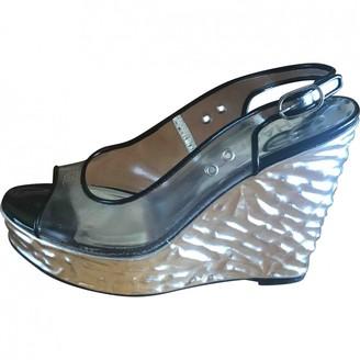 Chanel Silver Plastic Mules & Clogs