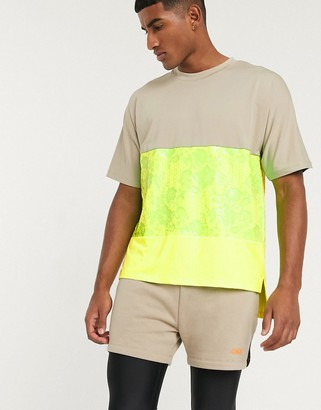 ASOS 4505 oversized t-shirt with neon panels and step hem