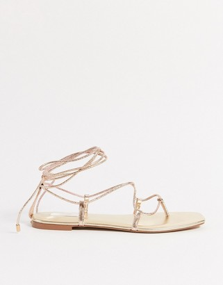 Stradivarius lace up sandal in gold