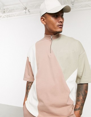 ASOS DESIGN oversized co-ord zip neck t-shirt with colour block body and chest embroidery in heavyweight jersey