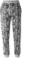 Kenzo snakeskin and logo print track pants