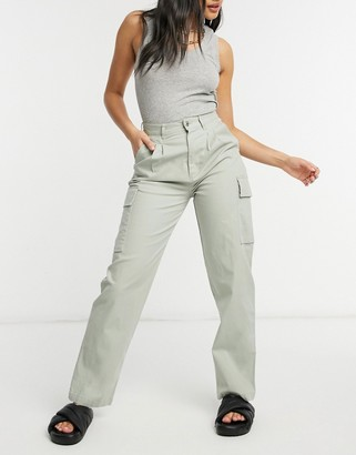 ASOS DESIGN pleat front chino with cargo pockets in sage