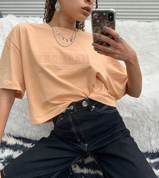 Reclaimed Vintage inspired t shirt with harmony print in washed orange