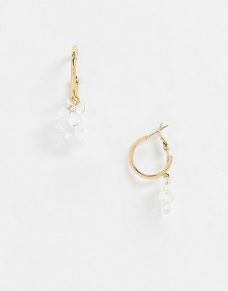 ASOS DESIGN hoop earrings with plastic sunflower charm in gold tone
