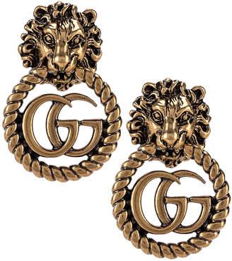 Gucci Lion Head Earrings in Gold   FWRD