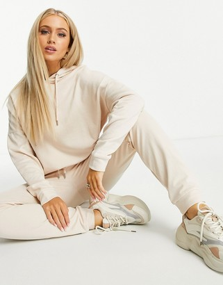ASOS DESIGN tracksuit hoodie and slim trackies with tie in organic cotton in cream