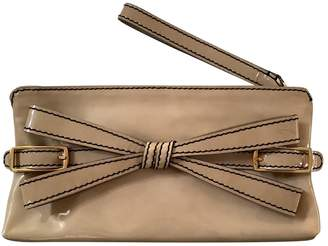 Valentino Beige Patent leather Clutch bags