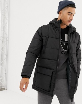 Nicce long line puffer jacket in black with hood