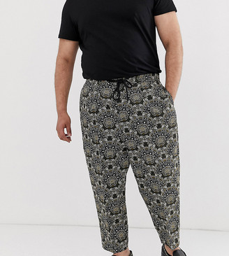 Asos Design DESIGN Plus drop crotch tapered smart pants in green floral jacquard with drawcord waist