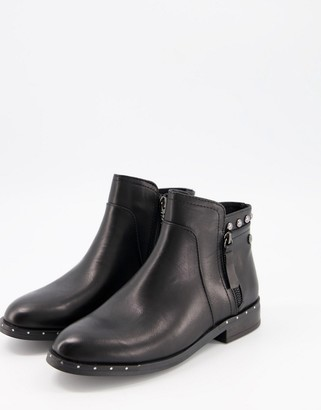 Xti side zip flat ankle boots with studs in black