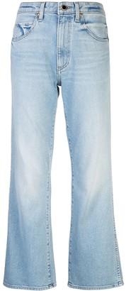 KHAITE Stonewashed Flared Jeans