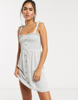 Accessorize beach button through dress in daisy print