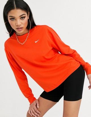 Nike red mini swoosh long sleeve t-shirt