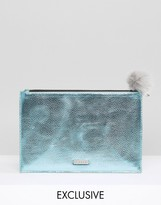 Skinnydip Exclusive Zip Top Clutch Bag in Metallic Blue with Gray Pom